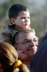 John Vargis, 2 years old of Ballston Spa, sits on his fathers head Ed listening to Christmas music at the Annual CP Holiday Train at the Saratoga Train Station. Photo Erica Miller 11/29/10 news_HolidayTrain3_Tues