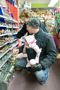 Jason and Stella Jenner look for holiday deals at G. Wilikers on Broadway in Saratoga with the help of grandmother Anna Molino during Black Friday. Photo Eric Jenks 11/26/10