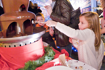 Emma Angelou dips a Marshmallow Longfellow's Dickens Village Festival Sunday. Attendees could look for gifts in a faux English market, visit with Santa, eat Victorian styled food and have a good time. Photo Eric Jenks 11/28/10