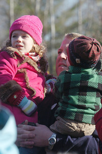Chris Larson, of Guilderland, holds his daughter Trinity, 3, and son Sean, 1, as they listen to holiday music at the Annual CP Holiday Train at the Saratoga Train Station. Photo Erica Miller 11/29/10 news_HolidayTrain2_Tues