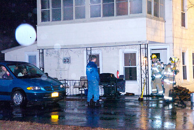 Saratoga Springs firefighters at the scene of Tuesday's fire on Ballston Ave. Ed Burke 11/29/10