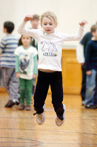 Erin Berls, 6 years old, leaps across the gym at Caroline Street Elementary for the 3 week Fitness Fun Monday evening, this is their 10th year. Photo Erica Miller 11/29/10 news_FitnessFun2_Tues