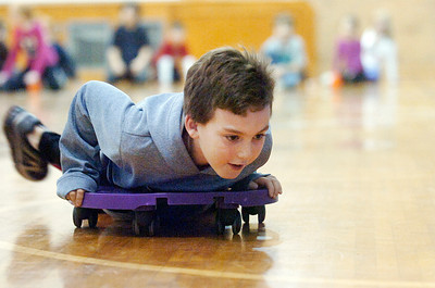 Evan Beckwith rolls his way across the gym at Caroline Street Elementary for the 3 week Fitness Fun Monday evening, this is their 10th year. Photo Erica Miller 11/29/10 news_FitnessFun3_Tues