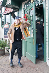 "David ""Tiny Tim"" Bedard greets incoming guests of Longfellow's Dickens Village Festival Sunday. Shoppers could look for gifts in a faux English market, visit with Santa, eat Victorian styled food and have a good time. Photo Eric Jenks 11/28/10"