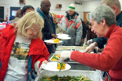 Volunteer Valerie Ayers, of Gansevoort, serves up fresh green beans at the Presbyterian New England Congregational Church Thursday morning for a Thanksgiving celebration. Photo Erica Miller 11/25/10 news_Thanksgiving3_Fri