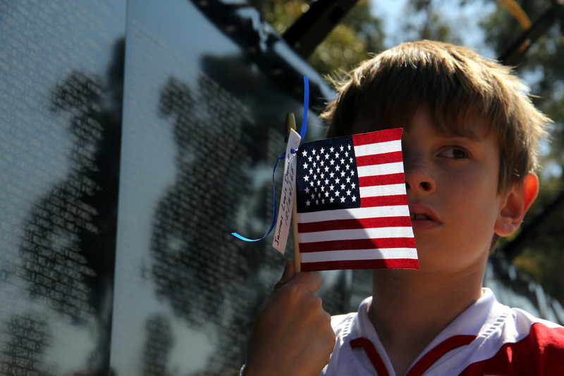 "The Vietnam War Wall Memorial came to Tri-City park in Placentia Ca – My father really wanted to share this event with Jr. (and the rest of us)  <br /> <br /> James Louis Douse - Killed in action on Christmas eve 1965. (See <a href=""http://army.togetherweserved.com/army/servlet/tws.webapp.WebApp?cmd=ShadowBoxProfile&type=Person&ID=46708"">http://army.togetherweserved.com/army/servlet/tws.webapp.WebApp?cmd=ShadowBoxProfile&type=Person&ID=46708</a> )  This man was in my fathers unit and was killed by a Claymore Mine while patrolling.   It seems that my dad did not know this person but does remember this tragic Christmas Eve event very well."