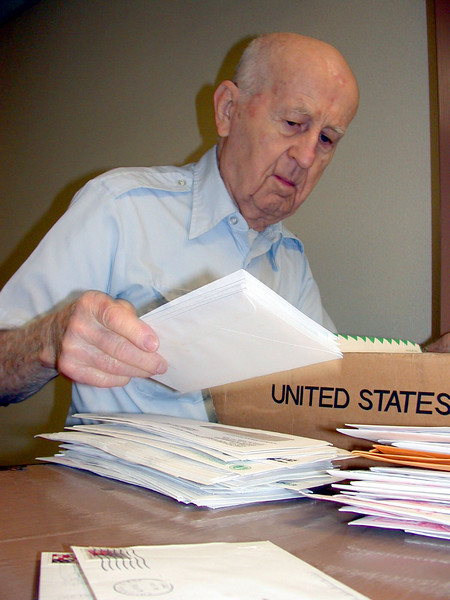 "RANDOLPH AIR FORCE BASE, Texas -- Martin ""Mike"" Mikulski, 90, sorts mail at the Air Force Personnel Center here.  A retired master sergeant and mailman, he has volunteered at the center and base chapel for 24 years.  (U.S. Air Force photo by 1st Lt. Brandon Lingle)"