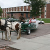 Visitors to the Chadron State College campus Saturday are treated to a horse-drawn tour. The tour was one of the college's many Family Day activities. (Photo by Justin Haag)