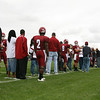 Chadron State College football players and their families line up along Elliott Field while being announced prior to Saturday's game. CSC's annual Family Day festivities brought hundreds of visitors to campus. (Photo by Justin Haag)