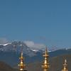 松赞林寺against background of snow capped mountains