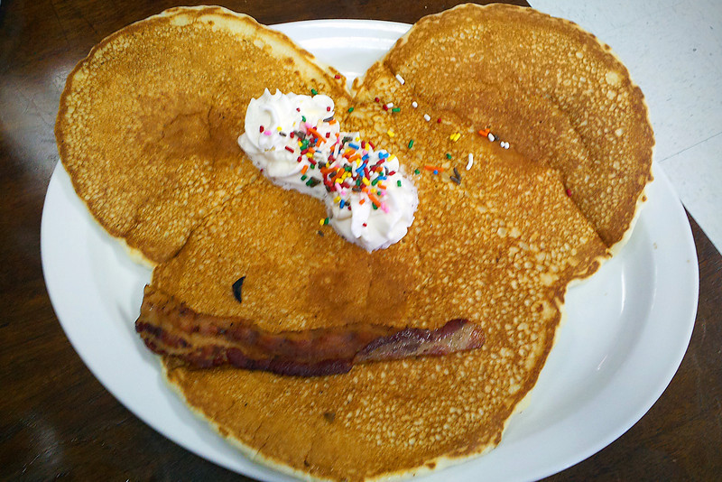 "24/365 - January 29, 2012 - Pancake a la Mickey <br /> <br /> I didn't get an opportunity to get the 5D out today, so I had to make do with a cell phone camera shot of Anna and Nathan's lunch at Connie's Kitchen on Chapman Highway in Seymour.  We almost ordered each kid their own, since it was $2.95.  Thankfully, the waitress clued us in on how big this thing was.  It's hard to get a sense of scale in a picture, but to put it in perspective, the plate is probably 12"" in diameter.  I would hate to see what the adult portion looks like..."