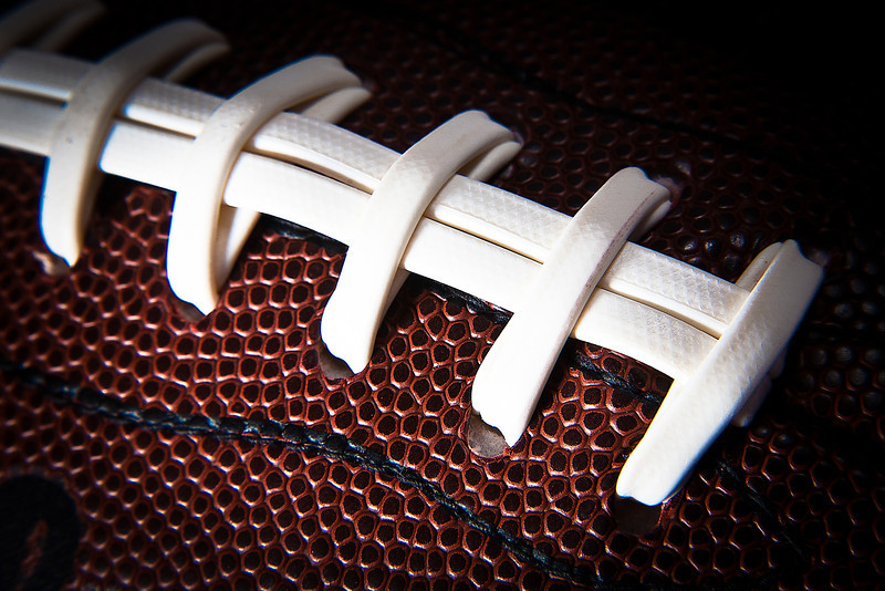 222/365 - August 14, 2012 - Laces Up <br /> <br /> With football season only a couple of weeks away, I grabbed a close up of a football under my lights.  I fitted my 24-105mm lens with a +4 macro filter to get in nice and tight.