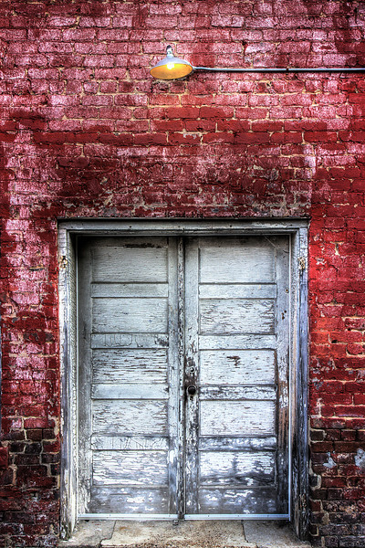 185/365 - Door of Yesteryear - July 8, 2012 <br /> <br /> On my way home from my parents', I made a quick stop in Clinton to get my photo of the day. This shot is of an old set of doors on the side of one of the antique shops just off of Market Street.