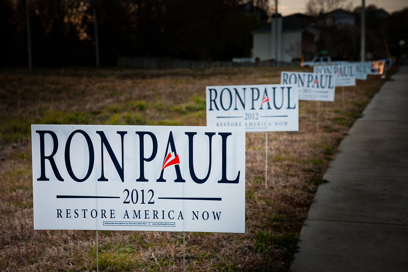 61/365 - March 6, 2012 - Super Tuesday <br /> <br /> Today's photo is somewhat lame, but since it was election day in Tennessee, I thought I would take a shot of the plethora of signs at my voting precinct.  Not that I am advocating Ron Paul, but I decided to use his signs since there were several aligned in a row.  The only other one that provided some repetition was Rick Santorum, and there was no way I was advertising for him on my Project 365.