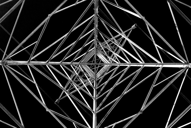 60/365 - March 5, 2012 - Web of Steel <br /> <br /> I had a really hard time deciding whether to go with the color version or black and white version of this shot.  As you can tell, I chose black and white.  It's a shot of an electric transmission line tower, directly beneath looking straight up.  The sky was a perfect blue, so the color shot turned out really good as well.  However, I chose this more abstract look that utilized a red filter to turn the blue to black.