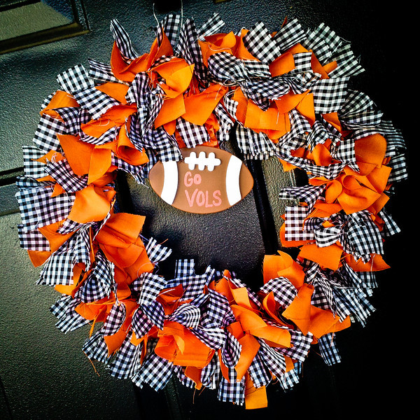 258/365 - September 19, 2012 - Go Vols Wreath <br /> <br /> Today's photo is showing off one of my wife's creations.  For the past year or so, she has been making wreaths for the various seasons to hang from our front door.  Today she finished up a Tennessee wreath for football season.  Isn't she talented?