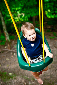156/365 - June 9, 2012 - Flying Nate   We spent the evening out at my parents having a cookout with some out of town relatives.  My shot tonight is another Nate shot.  This time he's enjoying the swing.