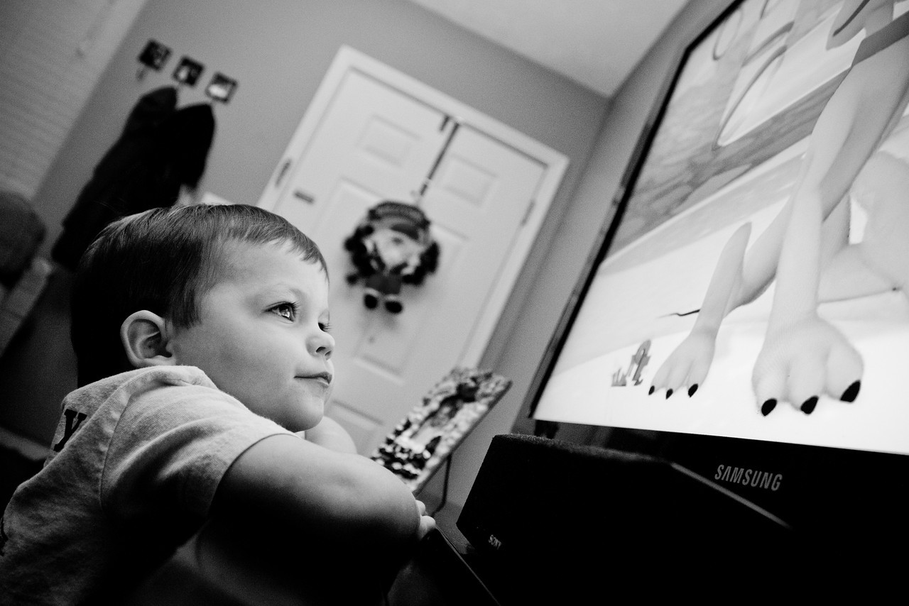 347/365 - December 17, 2012 - Fully Engaged <br /> <br /> Tonight while doing some laundry, I found an episode of Mickey Mouse Clubhouse to occupy the kids.  With Mickey being one of Nate's favorites, I found him glued to the television, watching very intently and could not pass up the opportunity to capture this shot.