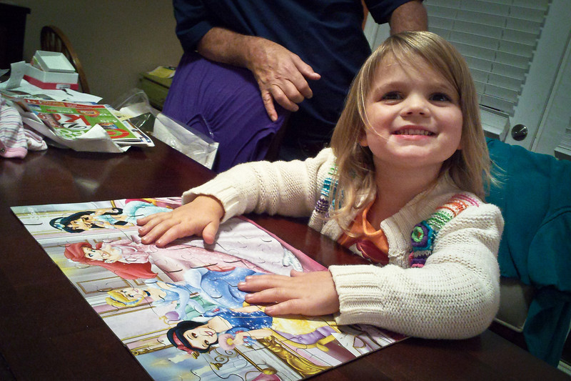 275/365 - October 6, 2012 - Puzzle Girl <br /> <br /> Tonight after my parents brought Anna home, she proceeded to prove all the doubters wrong and work the puzzle she insisted Nana and Papa buy her at Wal-mart.  They were sure she was too young for this puzzle.  Not sure you can tell from the photo, but this is a 48-piece puzzle that I would have never imagined in a million years a 3 year old could work.  Anna did it in less that 30 minutes unassisted by any adults.