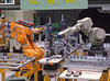 P9.3 / Automation photo / to replace image of hamburger flipper on page 233<br /> Choice 2 of 9<br /> <br /> Automated production and assembly: two robots working in tandem. (Newscom TagID: pttmedical013492) [Photo via Newscom]
