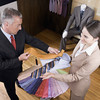 P16.7 / Follow-up the sale...suggesting something to complement what the customer purchased<br /> Choice 8 of 9<br /> <br /> Saleswoman assisting a businessman in a clothing store --- Image by © Glowimages/Corbis