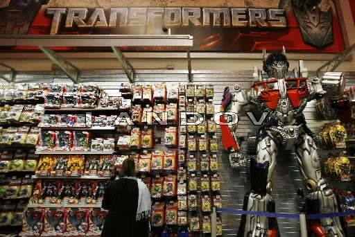"P3.5 Photo to illustrate licensing.<br /> <br /> Choice 18 of 18<br /> <br /> A woman shops for Transformers toys made by Hasbro, in New York,<br /> <br /> <a href=""http://www.nytimes.com/2012/02/13/business/media/hasbro-takes-more-of-its-toys-to-hollywood.html?_r=0"">http://www.nytimes.com/2012/02/13/business/media/hasbro-takes-more-of-its-toys-to-hollywood.html?_r=0</a>"