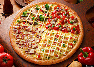 P3.6 / Different global tastes in pizza<br /> <br /> Choice  7 of 8<br /> <br /> Giant Quattro (divided into four topping areas, such as Charcoal Grilled Chiki-Teri, Domino Deluxe, Mayo Jaga, Garlic Master)