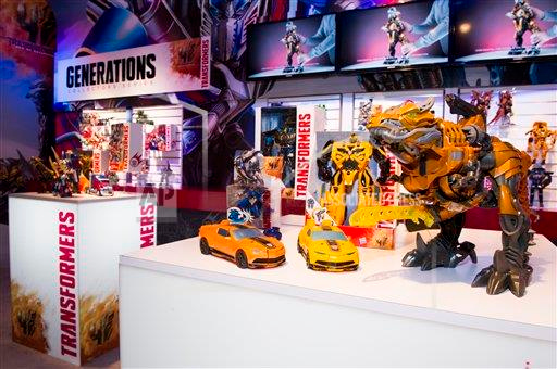 P3.5 Photo to illustrate licensing.<br /> <br /> Choice 16 of 18<br /> <br /> Hasbro, Inc. unveiled new toys from the TRANSFORMERS: Age of Extinction movie (out June 27) during the American International Toy Fair in New York City on Saturday, Feb. 15, 2014. The line includes toys that allow kids to quickly and easily convert their figures from robot to vehicle or dinosaur mode, including One-Step Changers and Chomp and Stomp GRIMLOCK. The movie toy line figures will be available in May 2014. (
