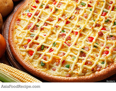 P3.6 / Different global tastes in pizza<br /> <br /> Choice  5 of 8<br /> <br /> The Domino's Mayo Potato pie (topped with onion, corn, potato, pancetta, paprika and mayo) in Japan.