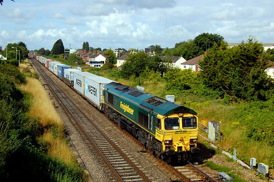 66526 Driver Steve Dunn on 4L31 0903 bristol to Felixstowe passing Highworth Jn 4 aug.Last day round here for a while as been transferred back to Heavy Haul