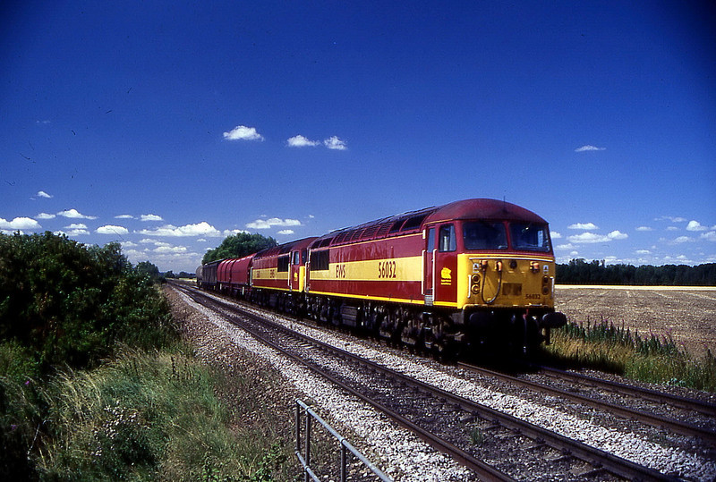56032 56011 on uid freight passing a farm crossing on scunthorpe to barnetby line 26 july 1999