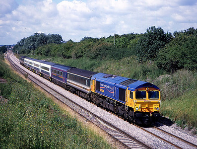 66718 on laira to ilford stock move pass the open heywood rd bridge 24 july