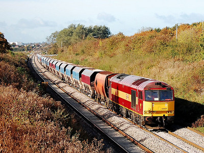 60009 6m20 1037 whatley to st pancras just after passing heywood rd junction 16 oct 2008.this bridge was the access point for cement workers to gain access to the canteen now closed off by the spikey fence.