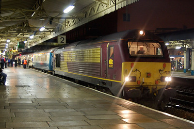67028 awaiting departure from newport with train to cardiff 15 dec 2008.the fatty in the orange hi vis tried to kick me off the station earlier when photographing WAG