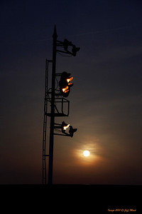 South end NB signals at Deshler, Ohio show an approach for a NB train along with a full moon