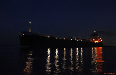 MV Sam Laud upbound in the St. Clair cutoff canal near midnight - taken from a downbound sailboat