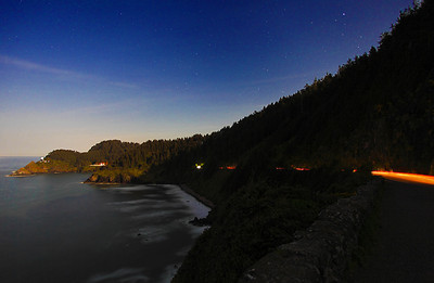 Moonlit Pacific.  The light on the left-hand side of the frame comes from the moon rising from the East.  The car trail and the stars are brought out with an extended exposure and hight ISO setting. May 2012, Central Oregon coast.