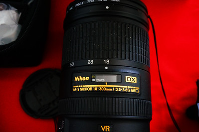 Nikon 18-300mm f/3.5-5.6 Lens.  Lens has 4 years left on a 5 year warranty.