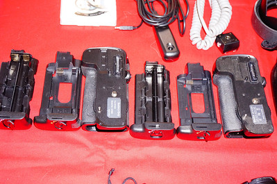 2 Battery Grips with 2 inserts for each one.  One holds a Nikon D7000 battery and the other one has AA battery inserts.