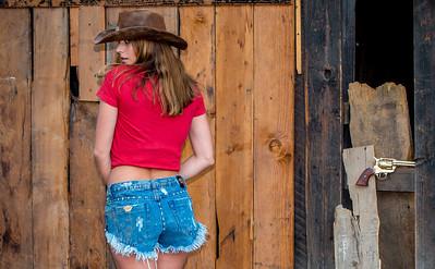 Nikon D800E Photos Pretty Cowgirl Model, Blue Jeans Cutoffs, Cowboy Hat, Cowboy Boots, & Gun! The Gold 45 Revolver!