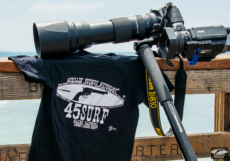Nikon D810 & 4K Sony Camcorder & 45surf  Achilles' Odyssey T-shirt Photos Taken by the Nikon D800E!  She (The  d800E) Was Jealous, But I still Love Her!The 45surfer bracket setup for  simultaneous stills and video (Nikon D810 + 150-600mm Tamron Zoom Lens  for Nikon + the new 4K Sony FDR-AX100/B 4K Video Camcorder) allows me to  shoot 4K video alongside 36mp stills of the Surf Goddesses!  Will be  using this setup at the Vans US Open of Surfing in late July in  Huntington Beach (Surf City USA!), and the Hurley Pro at Trestles in  September!  This power was simply inconceivable a few short years ago!   There was a lull so I shot some of the 45surf t shirts and 45surf  hoodies too!  Fall is around the corner when I sleep in my hoody every  night as the Malibu Canyons nights get cold!The Nikon D810 is the  hottest model I have shot to date, up there with the swimsuit bikini  model goddesses! :)JK, I could shoot the bikini models with a Canon 5D  MK3 even and they'd still look good.Shown with the Tamron SP 150-600mm  F/5-6.3 Di VC USD Lens for Nikon !  For shooting Alana Blanchard &  the surf goddesses at the Van's US Open in a couple weeks!Nikon D810 +  Sony FDR-AX100/B 4K Video Camcroder Photos Taken by Nikon D800E!  She  (the D800E) Was Jealous, But I still Love Her!The Nikon D 810 is mounted  on a sturdy aluminum Vanguard Tripod or quality Manfroto Monopod!  I  prefer the alunimum over the carbon as it is thinner and heavier and has  less of a chance of getting caught in a gust and tipping over!  Although  it happened once at the grand canyon, but I caught it!  But the  lightweight carbon-fiber with the wider legs would blow away! :)All the  best on your Epic Hero's Odyssey from Johnny Ranger McCoy! :)