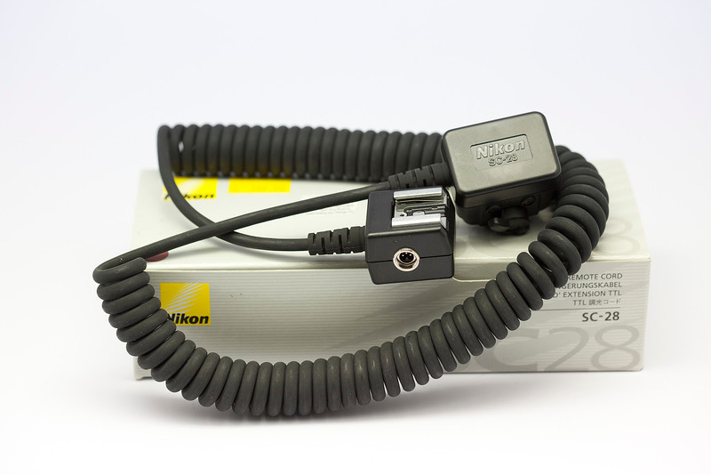 Nikon SC-28 Dedicated TTL Off Camera Coiled Sync Cord with Male & Female ISO Shoes. New.<br /> <br /> Asking Price: RM200. RESERVED.
