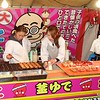 Women making food at a stall at a night food market as part of a cherry blossom festival in Fukuoka, Japan in March 2015