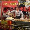 Woman preparing food at a night food market as part of a cherry blossom festival in Fukuoka, Japan in March 2015