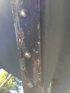 THIS IS THE BOTTOM OF THE RUDDER SKEG. YOU CAN SEE THE SCRAPES ON IT DOWN TO THE BARE METAL.