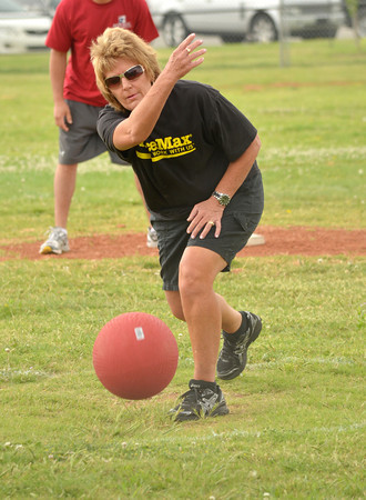Karla Standridge rolls the ball toward home plate Sunday afternoon during the Norman NEXT kickball tournament at Griffen Park.<br /> The tournament is a bi-annual event to raise money for Meals on Wheels and the Norman Addiction Information and Counseling.<br /> Transcript photo by Kyle Phillips