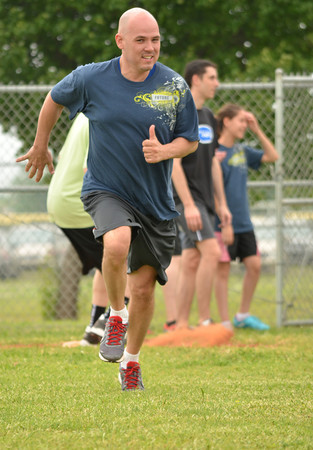 Bonner Slayton runs to second base after his teammate gets a hit during the Norman Next kickball tournament Sunday afternoon at Griffen Park.  The tournamnent is a bi-annual event to raise money for Meals on Wheels and the Norman Addiction Information & Counseling.<br /> Transcript Photo by Kyle Phillips