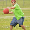 Brett Hoover throws the ball to first during the Norman NEXT kickball tournament at Griffen Park Sunday afternoon.  The bi-annual tournament is held to raise money for Meals on Wheels and the Norman Addiction Informantion and Counseling.<br /> Transcript Photo by Kyle Phillips