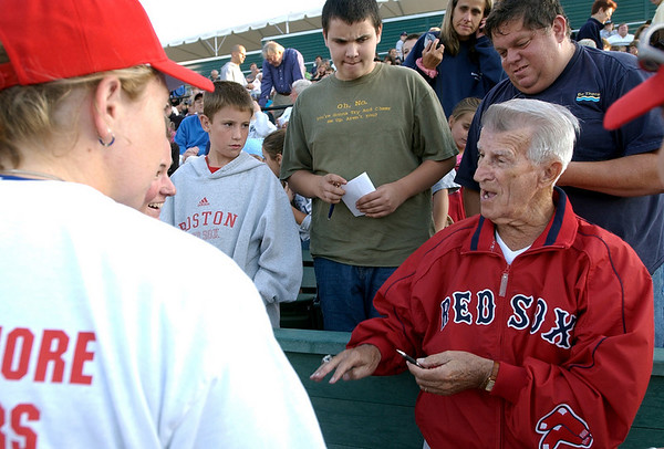 Lynn: Fans gather around to admire legendary Red Sox player Johnny Pesky's World Championship ring during a charity softball game at Frasier Field on Monday.<br /> Photo by Kira Horvath/Salem News Monday, August 15, 2005