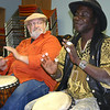 Gloucester: Mamadou Diop, drummer and guitarrist from Senegal, along with Don Goldman, left, performes at his drumming workshop for teens at the Sawyer Free Library on Saturday afteroon.  The event will be also helds this Saturday at 1pm. Events are free for public, paid for by Gloucester Cultural Council.<br /> Gloucester Daily Times/Silvie Lockerova